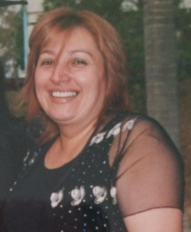 A photograph of Luz Marina Mendez de Arellano, smiling